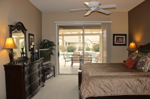 Master bedroom with sliding door to extended covered patio