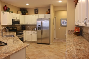 Upgraded kitchen with granite counter tops, bar and stainless appliances.